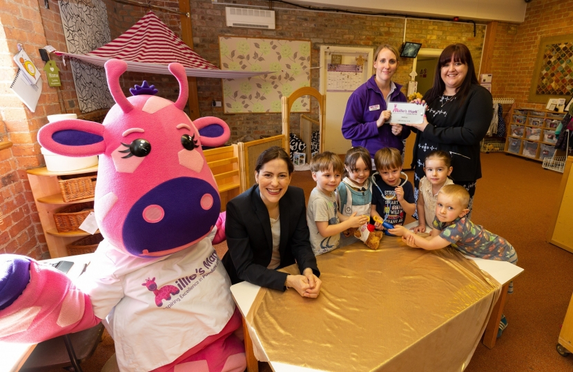 Millie the Giraffe and children at Wellies Nursery